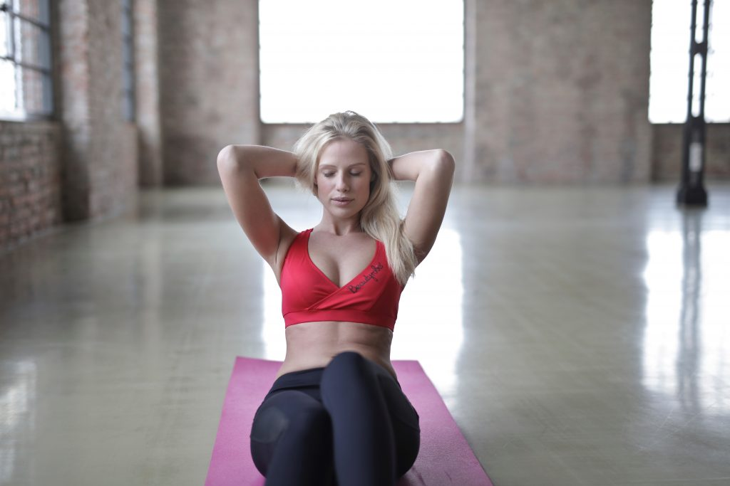 A young and beautiful lady doing exercise