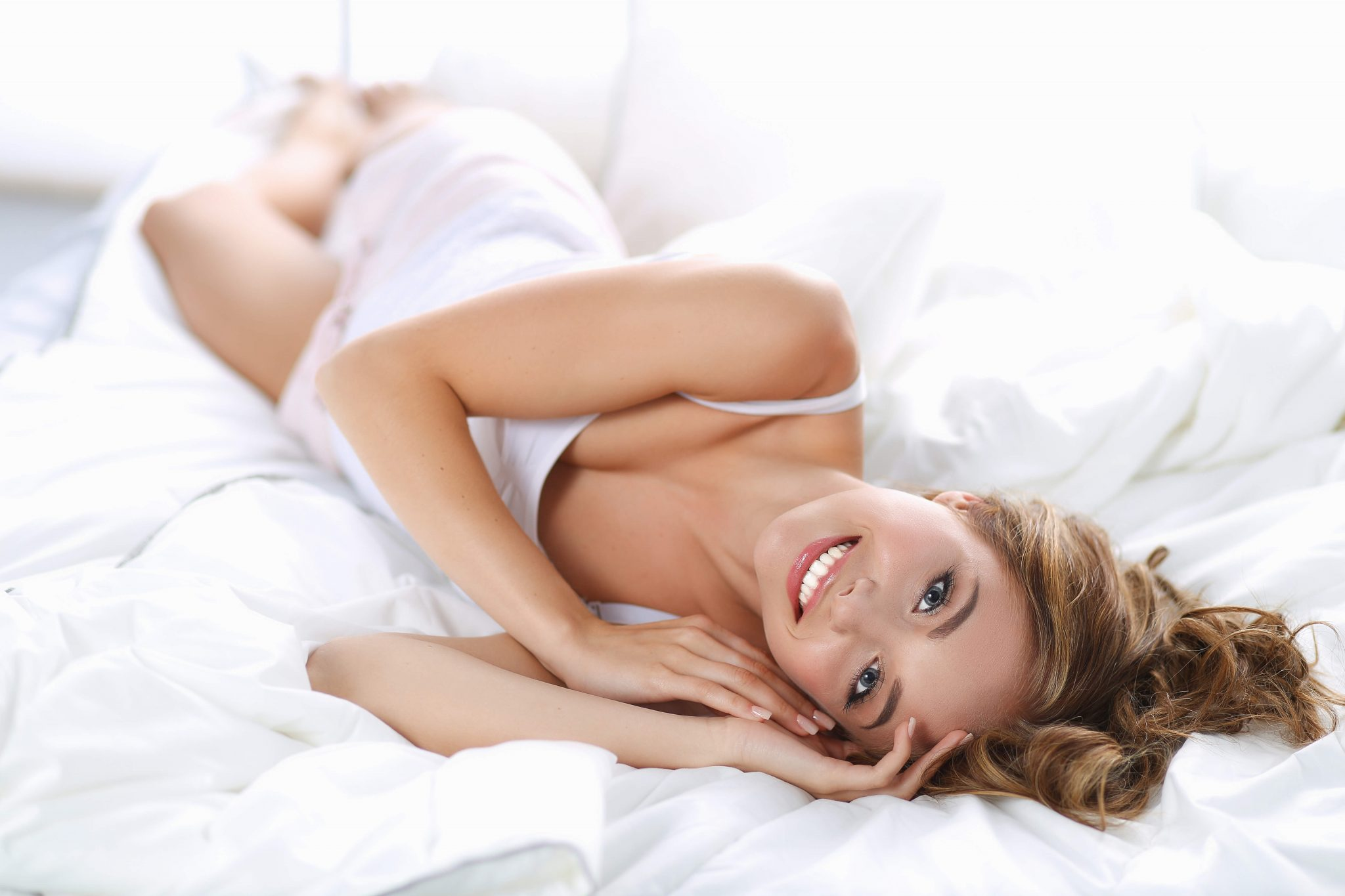 A young lady laying on bed