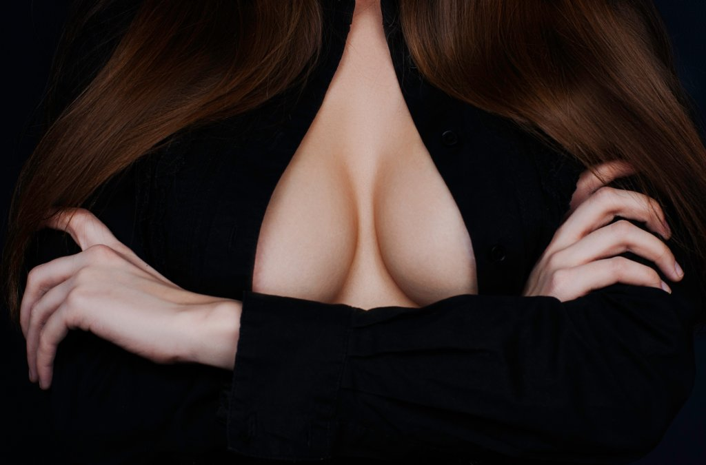 Woman body covering her breast