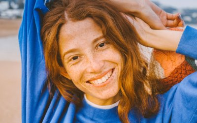 Freckly girl with big smile