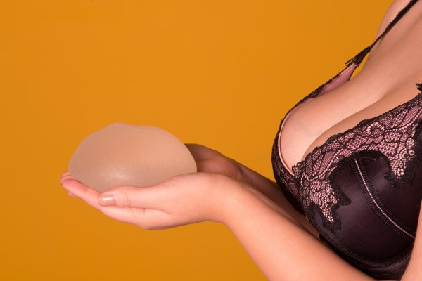 breast model with implant in hand