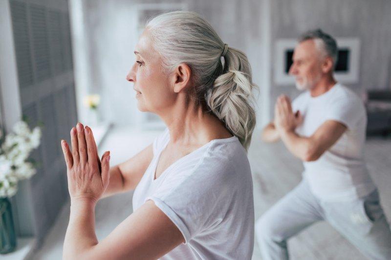 older-couple-doing-yoga-scaled.jpeg